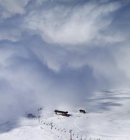 off piste: Ski resort in clouds. Caucasus Mountains, Georgia, region Gudauri. Top view.