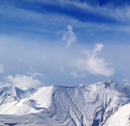 ski traces: View on off-piste snowy slope. Caucasus Mountains, Georgia, region Gudauri.