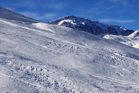 offpiste: Off-piste slope at sun windy day. Greater Caucasus, Mount Shahdagh. Qusar rayon of Azerbaijan. Stock Photo