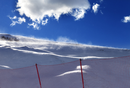 offpiste: Off-piste slope during a blizzard and sunlight blue sky. Greater Caucasus, Shahdagh. Qusar rayon of Azerbaijan. Stock Photo