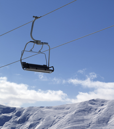 chair on the lift: Chair lift and snowy mountains at nice day. Caucasus Mountains, Georgia, region Gudauri.