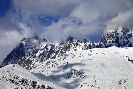 off piste: Snowy rocks in haze at sunny day. Caucasus Mountains. Svaneti region of Georgia.