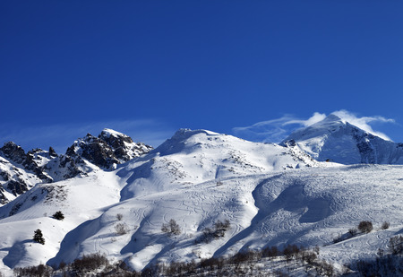 offpiste: Mount Tetnuldi and off-piste slope with track from ski and snowboard. Caucasus Mountains, Svaneti region of Georgia.