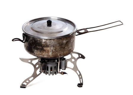 old gas stove: Camping gas stove and old sooty hiking pan. Isolated on white background