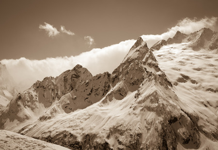 cocaine: Caucasus Mountains, region Dombay. Peak Ine. View from ski slope. Sepia toned.