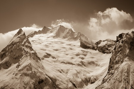 cocaine: Glacier in winter mountains. Caucasus Mountains, region Dombay, view from ski slope. Sepia toned. Stock Photo