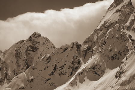 soft peak: Snowy mountains in clouds. Caucasus Mountains, region Dombay. Toned landscape.