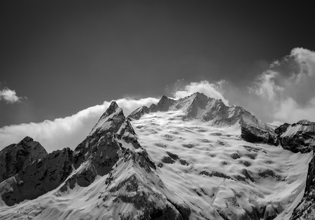 cocaine: Black and white Caucasus Mountains in cloud. Region Dombay. Peak Ine. View from ski slope.