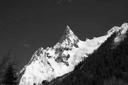 cusp: Black and white mountain peak in snow. Caucasus Mountains, region Dombay, peak Ine. Stock Photo