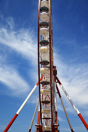 ferriswheel: Ferris wheel and blue sky with clouds. Wide angle view. Stock Photo