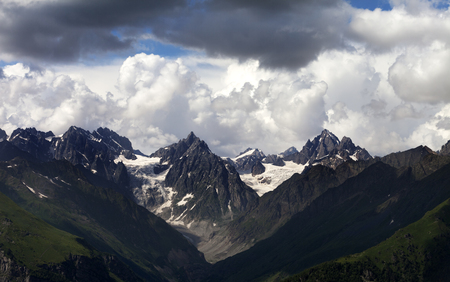 crack climbing: Summer mountains and cloudy sky. Caucasus Mountains. Georgia, region Svanetia.