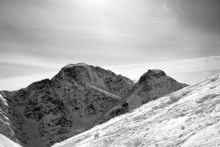 offpiste: Black and white off-piste slope. Mount Cheget, Caucasus Mountains, Elbrus region. Stock Photo