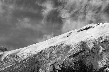 offpiste: Black and white view on off-piste ski slope. Caucasus Mountains, mount Cheget, Elbrus region. Stock Photo