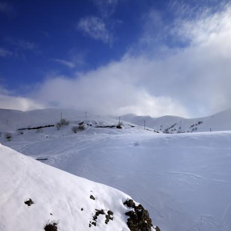 offpiste: View of off-piste slope and mountains in haze. Caucasus Mountains, Georgia, region Gudauri. Stock Photo