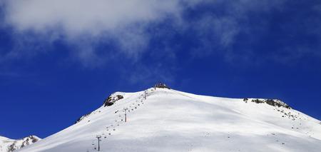 ropeway: Panoramic view on ropeway and ski slope in sun day. Caucasus Mountains, Georgia, region Gudauri.
