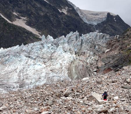 crack climbing: Glacier and hiker on moraine. Caucasus Mountains, Georgia, region Svanetia.