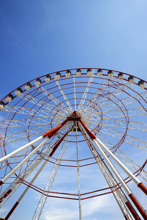 ferriswheel: Ferris wheel and blue sky in sun day. Wide angle view.