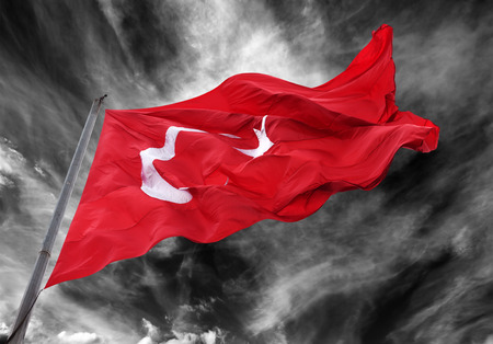 Waving flag of Turkey against black and white storm sky