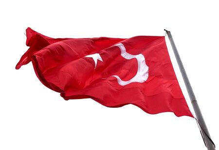 Flag of Turkey waving in wind day. Isolated on white background.