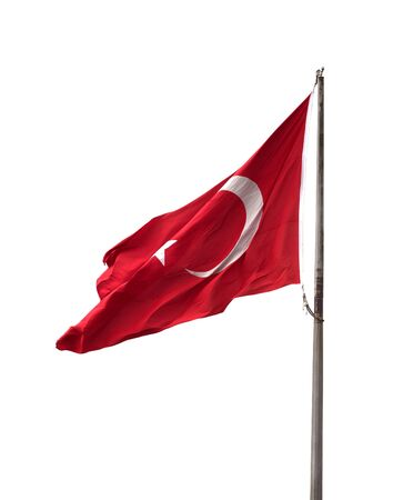 Turkish flag on flagpole waving in windy day. Isolated on white background. Stock Photo