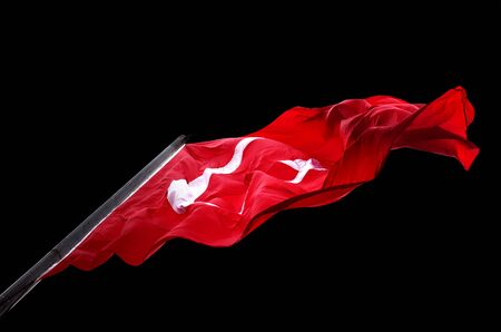 Waving flag of Turkey isolated on black background. Bottom view