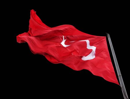 Waving flag of Turkey isolated on black background