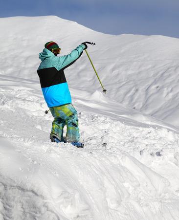 offpiste: Skier on off-piste slope in sun cold day