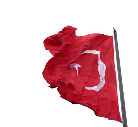 Waving in wind flag of Turkey on flagpole. Isolated on white background.