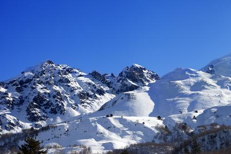 off piste: Snowy mountains and off-piste slope on sunny day. Caucasus Mountains, Tetnuldi, Svaneti region of Georgia.