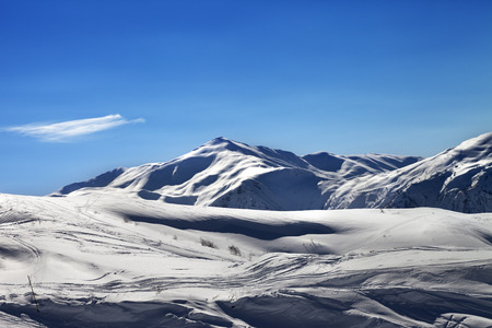 Off-piste ski slope in sunny evening. Caucasus Mountains, Tetnuldi, Svaneti region of Georgia.