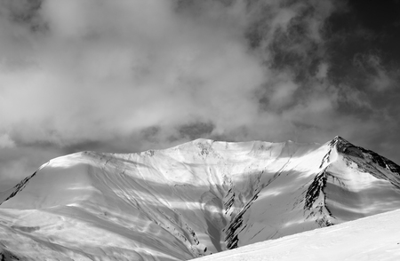 piste: Black and white view on off-piste snowy slope in wind day. Caucasus Mountains, Georgia, region Gudauri.