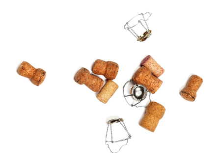 corked: Corks from champagne wine and muselets. Isolated on white background with copyspace. View from above.