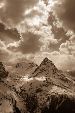 Winter mountain. Caucasus Mountains, region Dombay, mount Belalakaya in cloud. Toned landscape