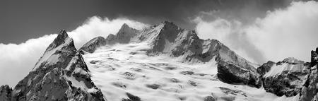 cocaine: Black and white panorama of winter mountains. Caucasus Mountains, region Dombay. Peak Ine.
