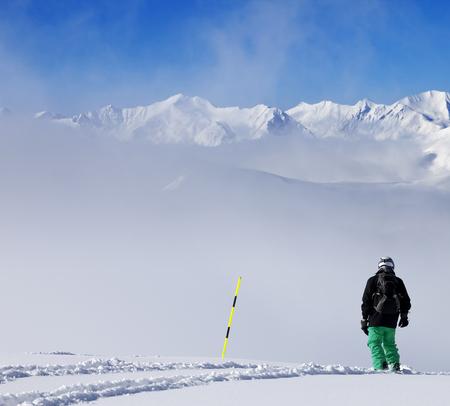 Snowboarder on snowy slope with new fallen snow. Caucasus Mountains, Georgia, region Gudauri. Stock Photo