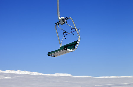 ski traces: Chair-lift in ski resort at sun day. Close-up view. Greater Caucasus, Mount Shahdagh. Qusar rayon of Azerbaijan.