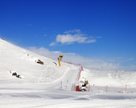 Ski slope with snowmaking at sun day. Greater Caucasus, Shahdagh, Azerbaijan.