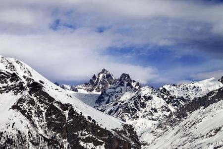 Snow mountain in sun winter day, view from ski slope. Caucasus Mountains. Svaneti region of Georgia.