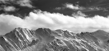 fog white: Black and white panoramic view on snow winter mountains and sunlight cloud sky in evening. Caucasus Mountains. Svaneti region of Georgia. Stock Photo