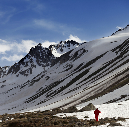 Hiker at snowy mountains in sun evening. Turkey, Kachkar Mountains in spring (highest part of Pontic Mountains).