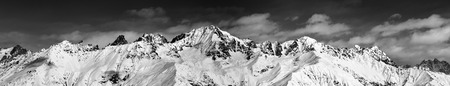 Large panoramic view on snowy mountains in sunny day. Caucasus Mountains. Svaneti region of Georgia. Black and white toned landscape.