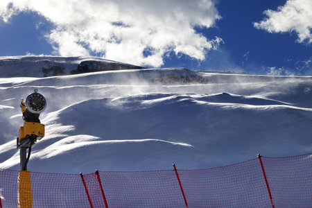 Off-piste slope during blizzard and sunlight blue sky with clouds. Greater Caucasus, Shahdagh, Azerbaijan.