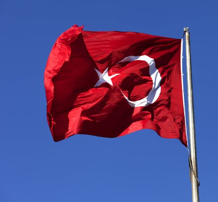 Turkish flag waving in wind at sun day