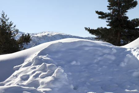 snowbank: Snowdrifts in mountain after snowfall at sun winter day. Caucasus Mountains. Svaneti region of Georgia.  Stock Photo