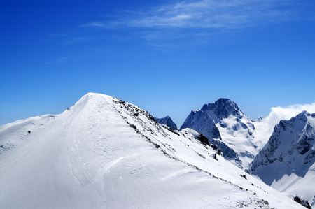 Slope for freeriding in sun winter day. Caucasus, region Dombay, top of mount Musa Achitara.  Stock Photo