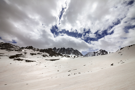 Snow mountain and cloud sky in gray spring day. Turkey, Kachkar Mountains, highest part of Pontic Mountains. Wide angle view.