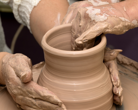 Two Women In Process Of Making Clay Vase On Pottery Wheel Potters