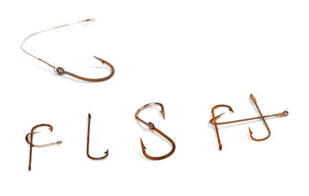 Word F I S H composed of old rusty fish hook. Isolated on white background with copy space. Selective focus.