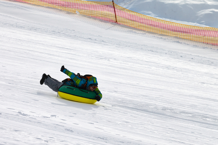 Snow tubing at sun winter day on ski resort