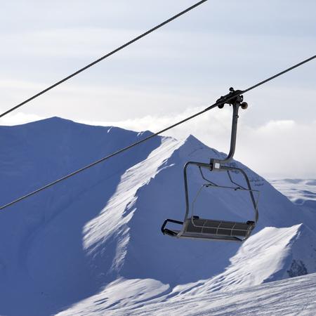 Chair lift and mountains in evening. Caucasus Mountains, Georgia, region Gudauri. Stock Photo